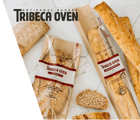 Overhead of various packaged and sliced artisanal breads from Tribeca Oven