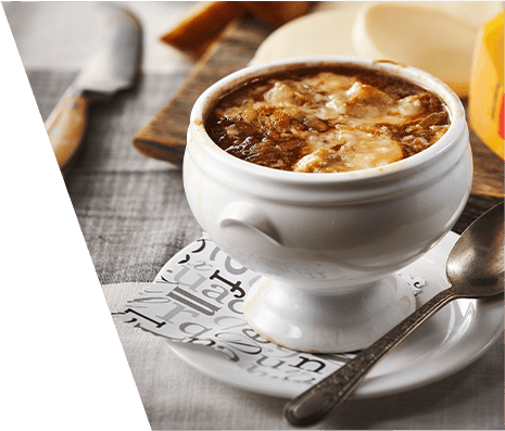 A bowl of French onion soup with cheese
