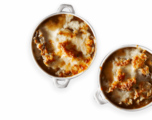 Overhead view of 2 bowls of French onion soup